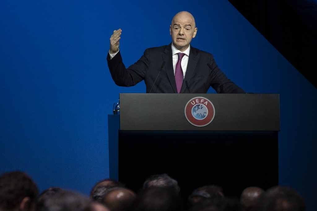 FILE - In this Tuesday, March 3, 2020 file photo, FIFA President Gianni Infantino addresses a meeting of European soccer leaders at the congress of th...