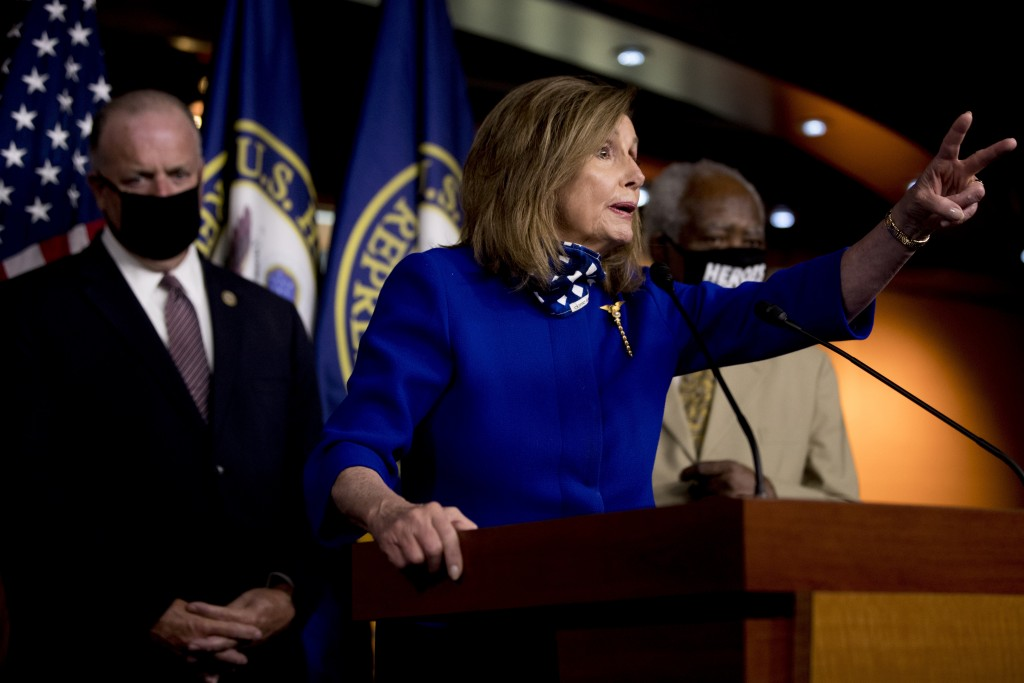 House Speaker Nancy Pelosi of Calif., accompanied by Rep. Dan Kildee, D-Mich., left, and Rep. Danny Davis, D-Ill., right, speaks at a news conference ...