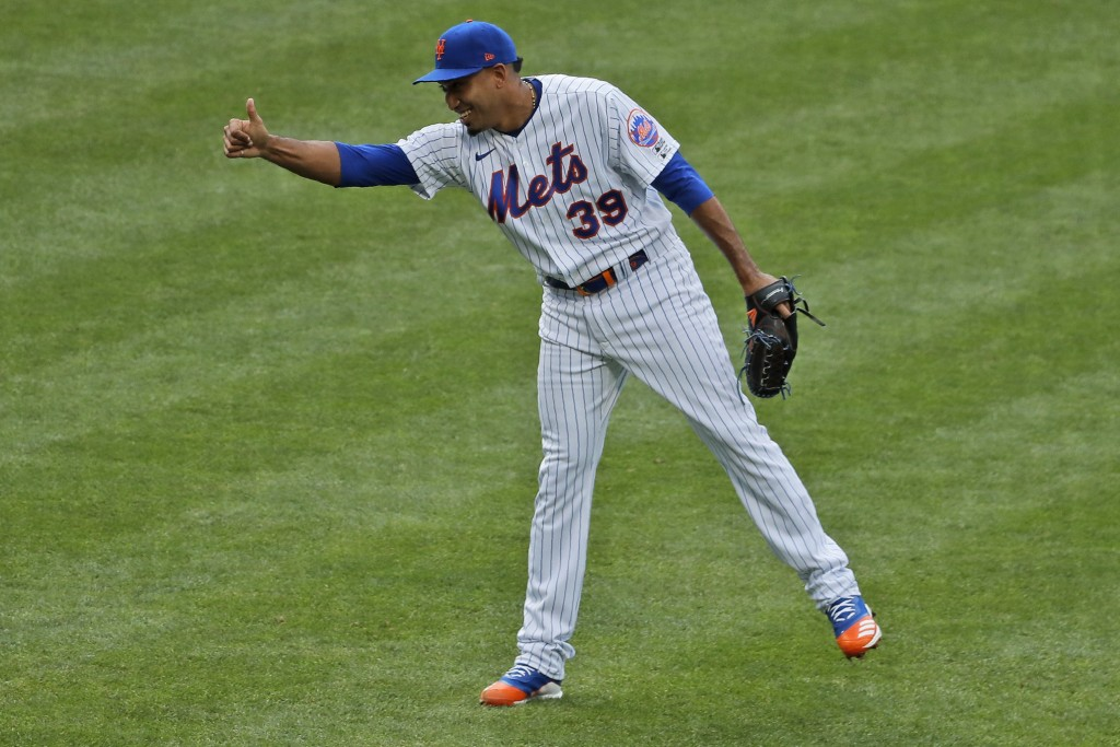 New York Mets relief pitcher Edwin Diaz reacts after the last out of a baseball game against the Atlanta Braves at Citi Field, Friday, July 24, 2020, ...