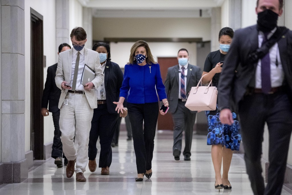 House Speaker Nancy Pelosi of Calif. arrives at a news conference on Capitol Hill in Washington, Friday, July 24, 2020, on the extension of federal un...
