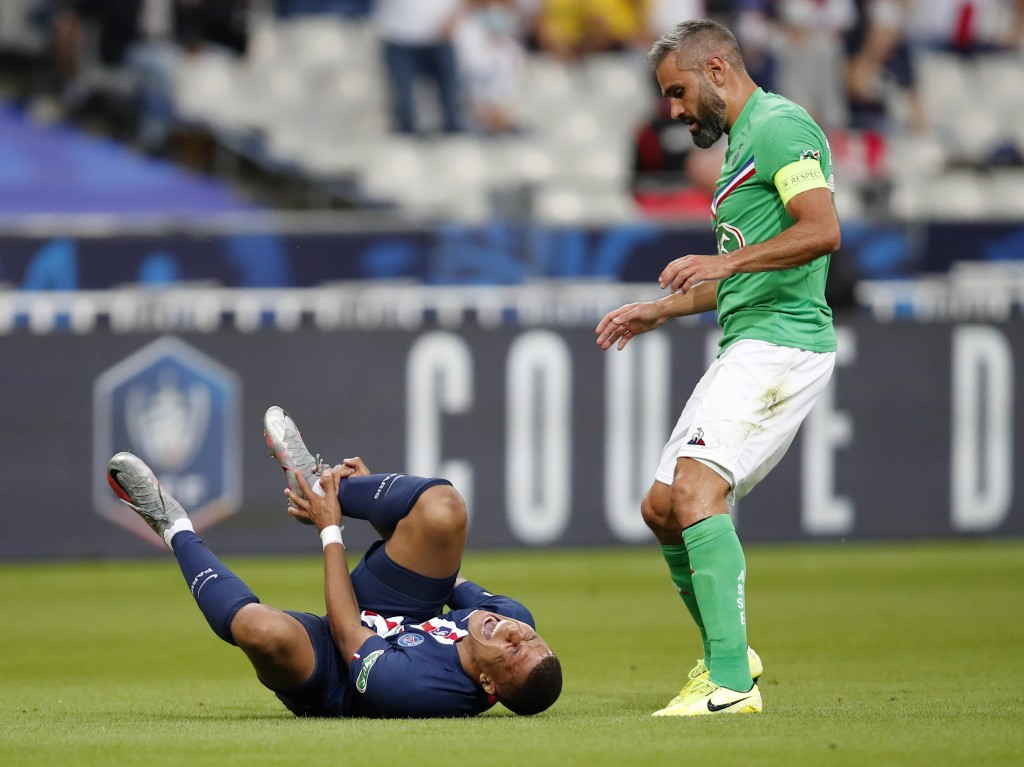 PSG's Kylian Mbappe, left, shouts in pain after being tackled by Saint-Etienne's Loic Perrin, right, during the French Cup soccer final match between ...