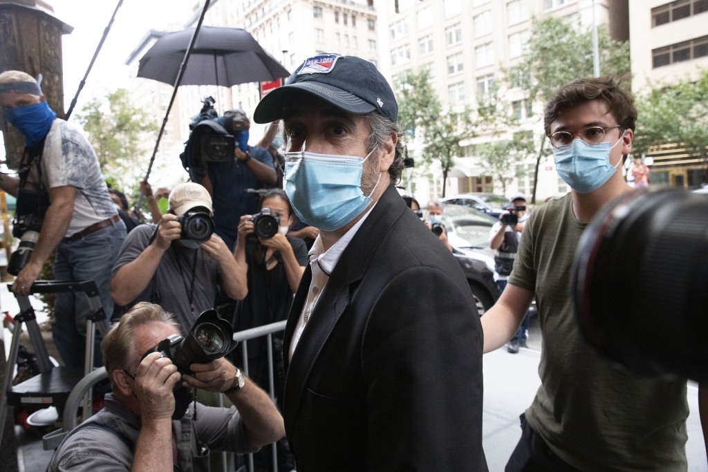 Michael Cohen, President Donald Trump's former personal attorney, returns to his apartment after being released from prison, Friday, July 24, 2020, in...