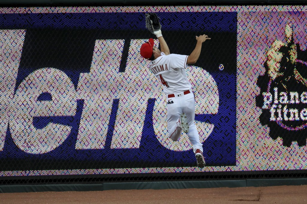 Cincinnati Reds' Shogo Akiyama (4) leaps to grab a ball hit by Detroit Tigers' Harold Castro (30) in the eighth inning during a baseball game against ...
