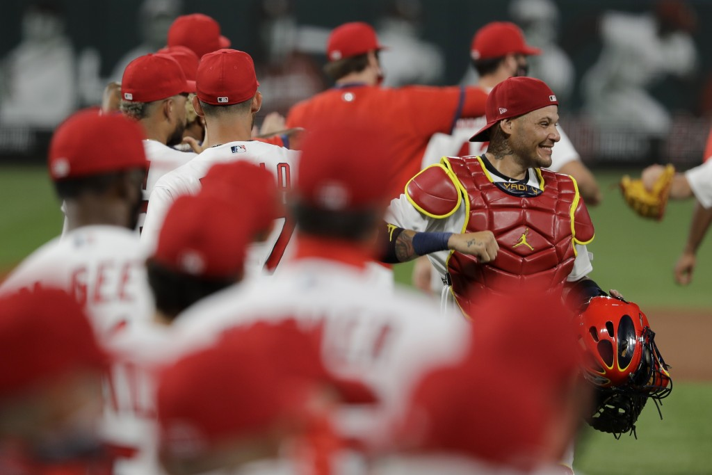 St. Louis Cardinals catcher Yadier Molina, right, celebrates a 5-4 victory over the Pittsburgh Pirates in a baseball game Friday, July 24, 2020, in St...