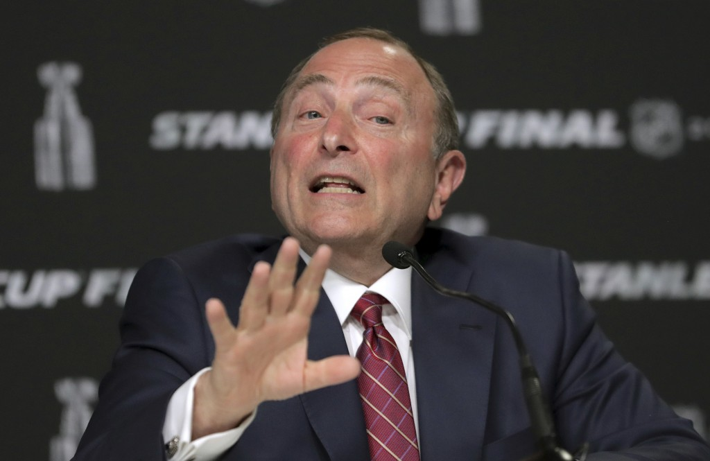 FILE - In this May 27, 2019, file photo, NHL Commissioner Gary Bettman speaks to the media before Game 1 of the NHL hockey Stanley Cup Final between t...
