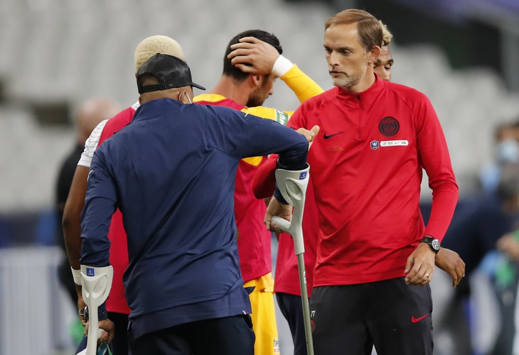 PSG's head coach Thomas Tuchel, right, talks to injured PSG's Kylian Mbappe after the French Cup soccer final match between Paris Saint Germain and Sa...
