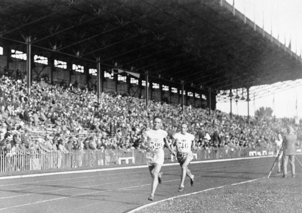 FILE - In this 1924 file photo, Vilho Ritola, of Finland, leads the field during the men's 10,000-meter race at the 1924 Olympics in Paris. Ritola won...