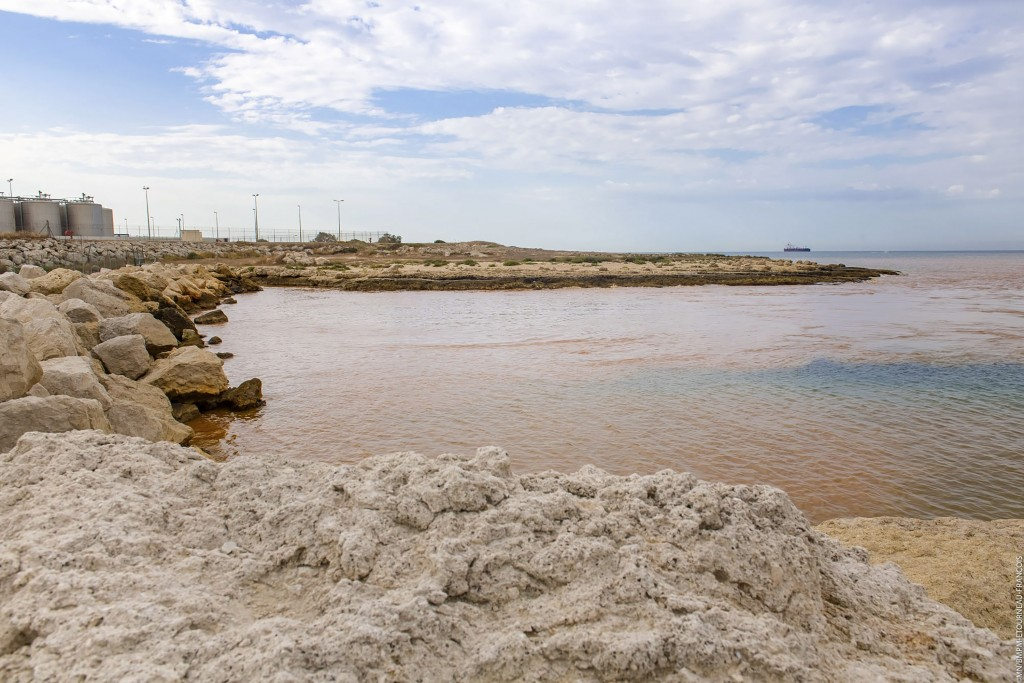 In this photo made available by the Fire brigade of Marseille, the orange-brown sheet of pollution is seen in the Mediterranean sea at Martigues, near...
