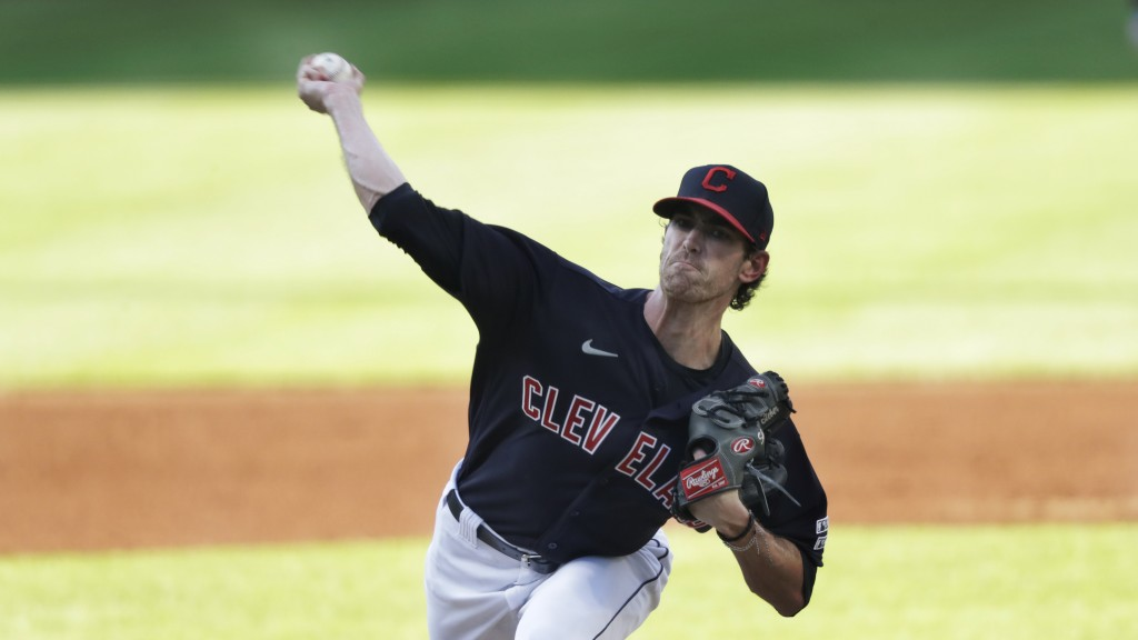 Cleveland Indians starting pitcher Shane Bieber delivers in the first inning in a baseball game against the Kansas City Royals, Friday, July 24, 2020,...