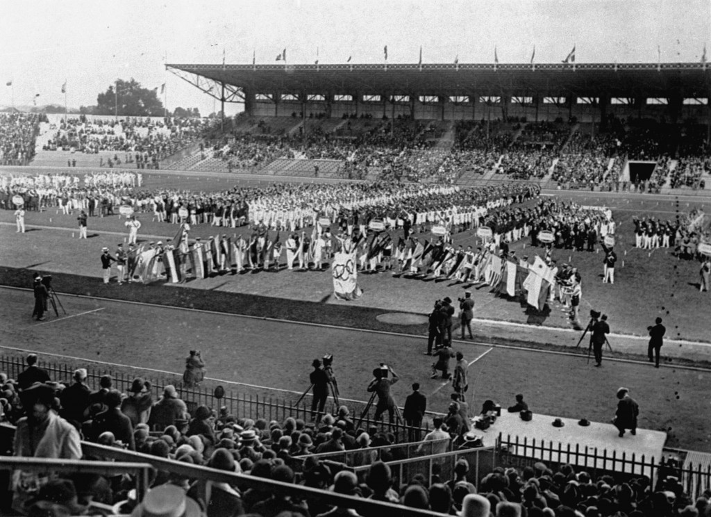 FILE - This July 15, 1924 file photo shows the opening of the 1924 Olympics at Colombes Stadium, Paris, as competing athletes lined up on the field an...