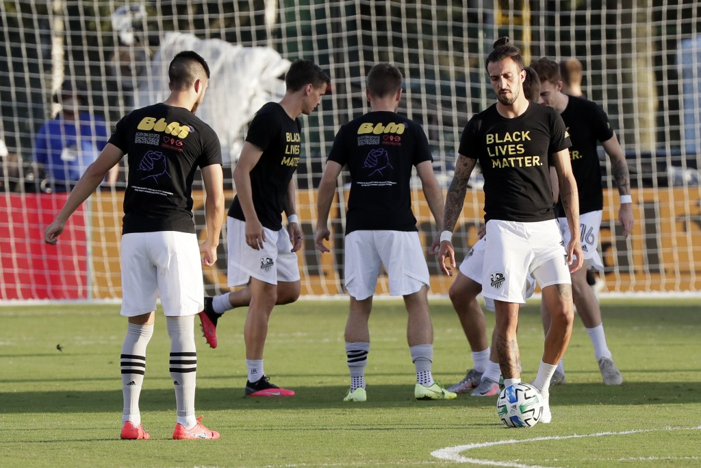 Montreal Impact players warm up wearing Black Lives Matter t-shirts before an MLS soccer match against Orlando City, Saturday, July 25, 2020, in Kissi...