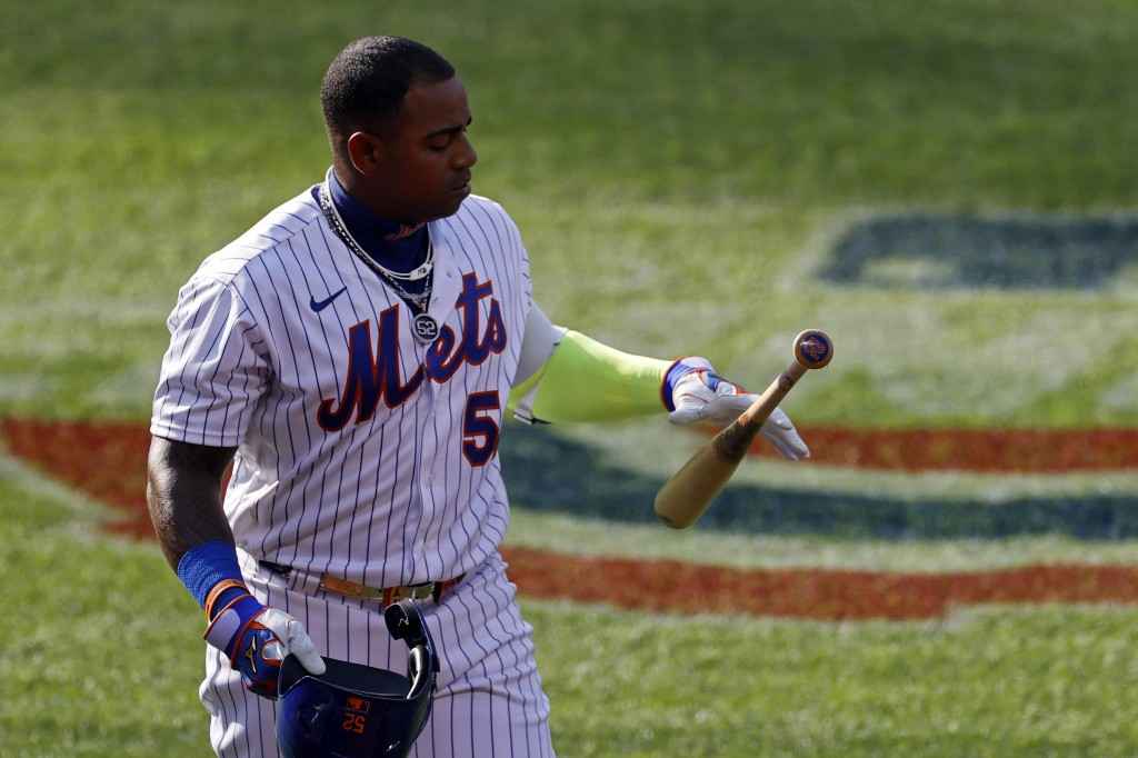 New York Mets' Yoenis Cespedes reacts after striking out against the Atlanta Braves during the sixth inning of a baseball game Saturday, July 25, 2020...