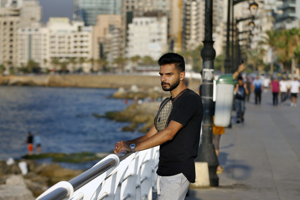 Lebanese Ali Mallah, 27, who recently lost his job as a salesman at a shoe store in Beirut, stands on Beirut's waterfront promenade on the Mediterrane...