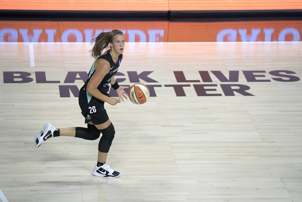 New York Liberty forward Sabrina Ionescu (20) pushes the ball up the court during the first half of a WNBA basketball game against the Seattle Storm, ...