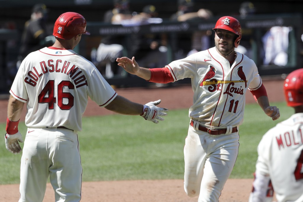 St. Louis Cardinals' Paul DeJong (11) celebrates with Paul Goldschmidt (46) after both players scored on a double by Matt Carpenter during the eighth ...