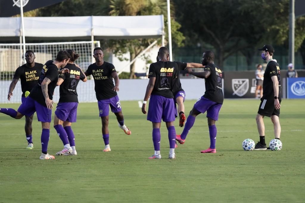 Orlando City players warm up wearing Black Lives matter t-shirts before an MLS soccer match against the Montreal Impact, Saturday, July 25, 2020, in K...