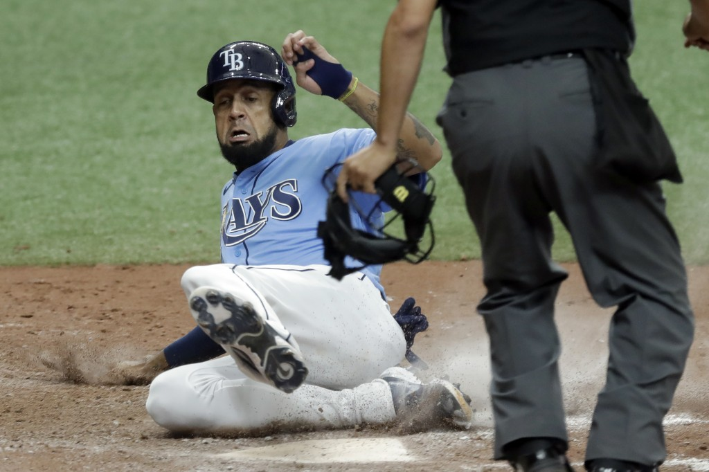 Tampa Bay Rays' Jose Martinez scores the game-winning run on a two-run, walk-off double by Kevin Kiermaier off Toronto Blue Jays relief pitcher Shun Y...