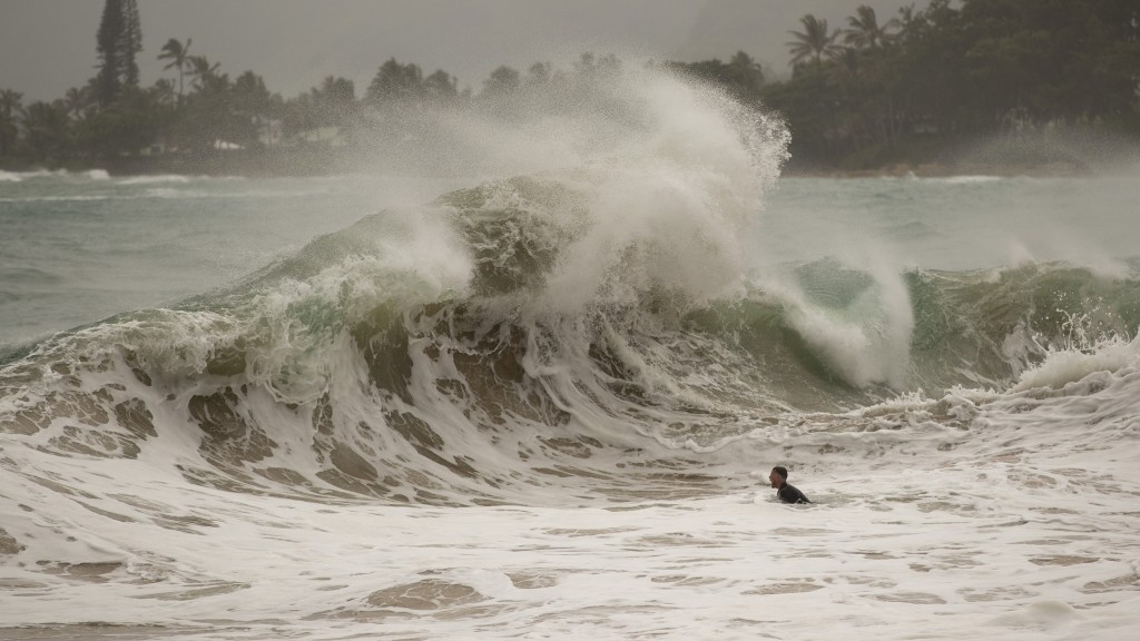 A body surfer prepares to dive under a large wave generated by Hurricane Douglas, at Laie Beach Park, Sunday, July 26, 2020, in Laie, Hawaii. (AP Phot...