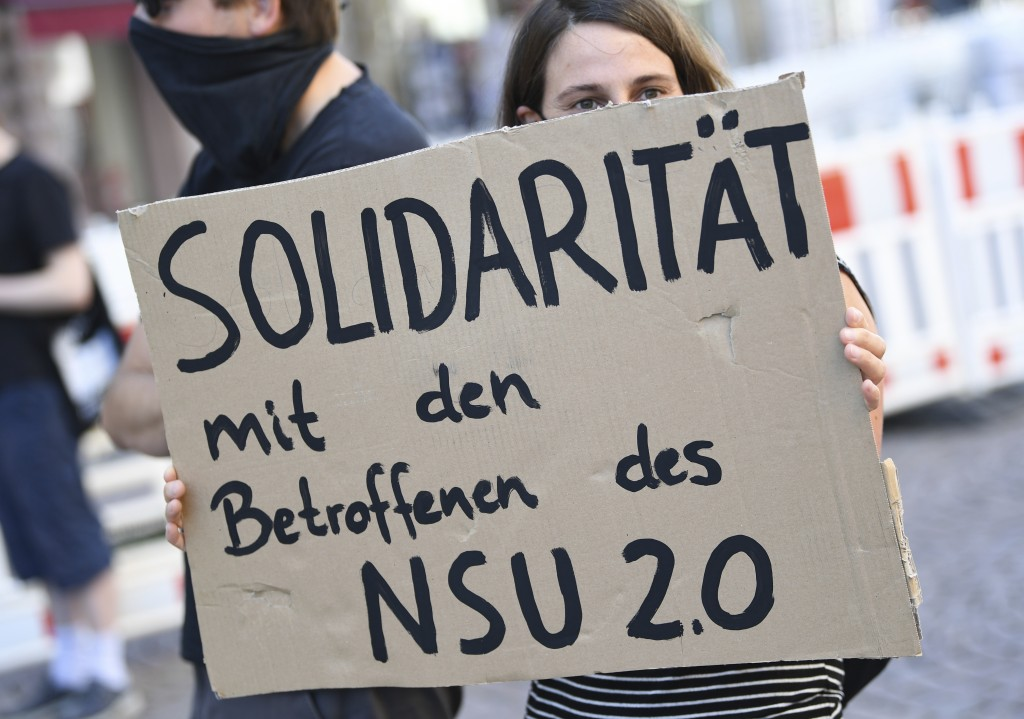 A demonstrator holds a poster with the inscription 'Solidarity with those affected by NSU 2.0'  during a rally in downtown Wiesbaden, Germany, Tuesday...