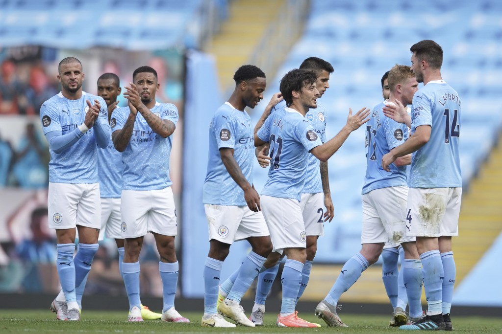 Manchester City's David Silva is applauded by team mates at the end of the English Premier League soccer match between Manchester City and Norwich Cit...