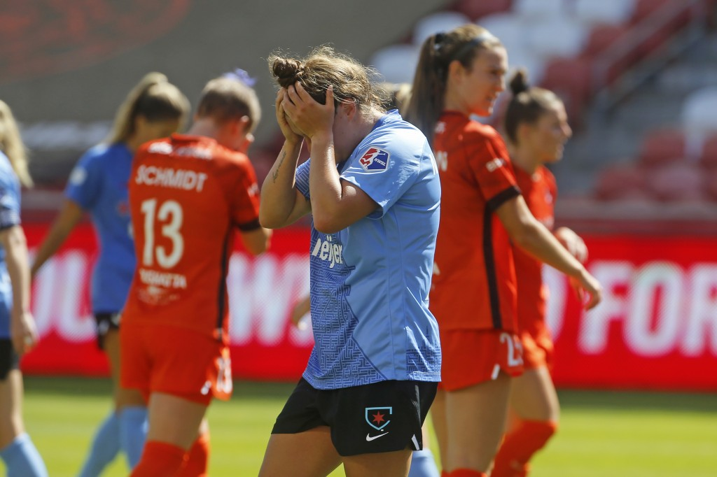 Chicago Red Stars' Savannah McCaskill, center, hold's her head after missing a goal against the Houston Dash during the first half of an NWSL Challeng...