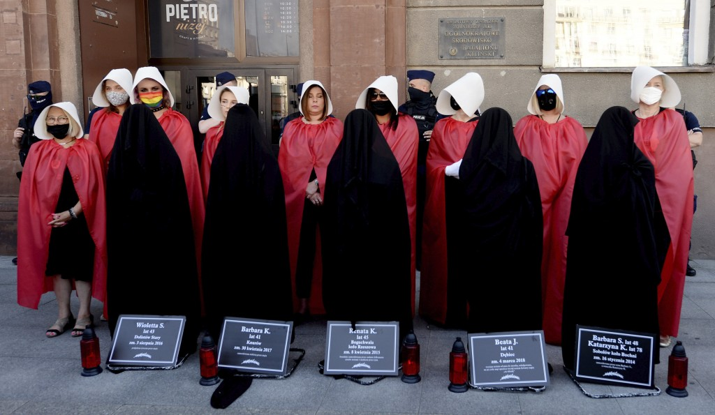 Members of Poland's women's rights organizations, with obituaries of women who fell victim to violence, protest against plans by the right-wing govern...