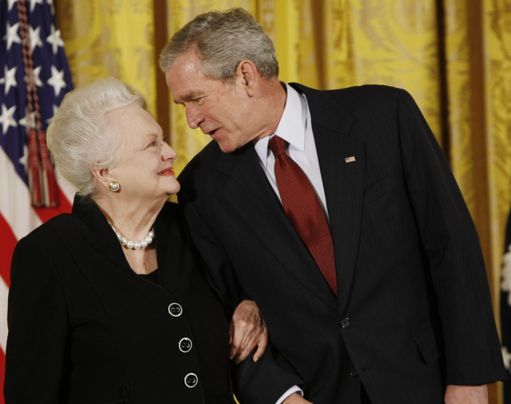 FILE - In this file photo dated Monday, Nov. 17, 2008, US President George W. Bush greets actress Olivia de Havilland as he presented her with the 200...