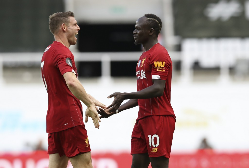 Liverpool's Sadio Mane, right, celebrates with James Milner after scoring his side's third goal during the English Premier League soccer match between...