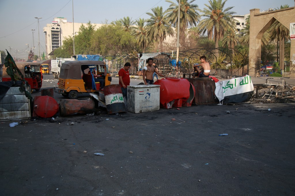 Anti-government protesters gather by barriers near Tahrir square, Baghdad, Iraq, Monday, July, 27, 2020. Fresh violence erupted between demonstrators ...