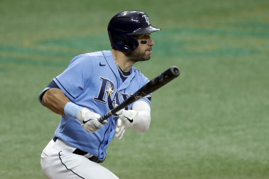Tampa Bay Rays' Kevin Kiermaier follows the flight of his two-run walkoff double off Toronto Blue Jays relief pitcher Shun Yamaguchi during the 10th i...