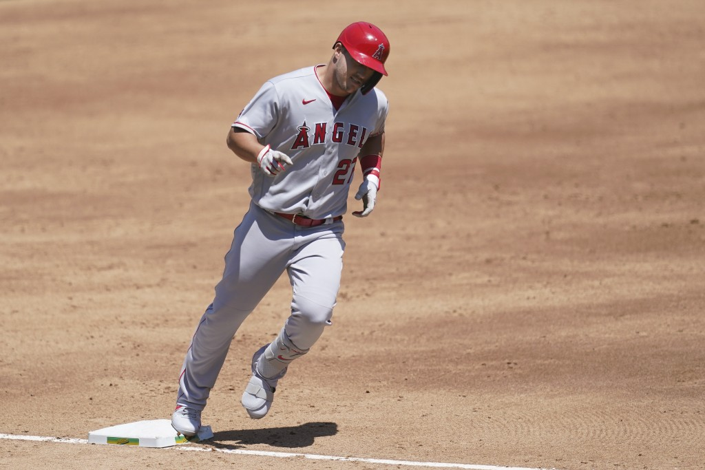 Los Angeles Angels' Mike Trout rounds the bases after hitting a three-run home run against the Oakland Athletics during the third inning of a baseball...