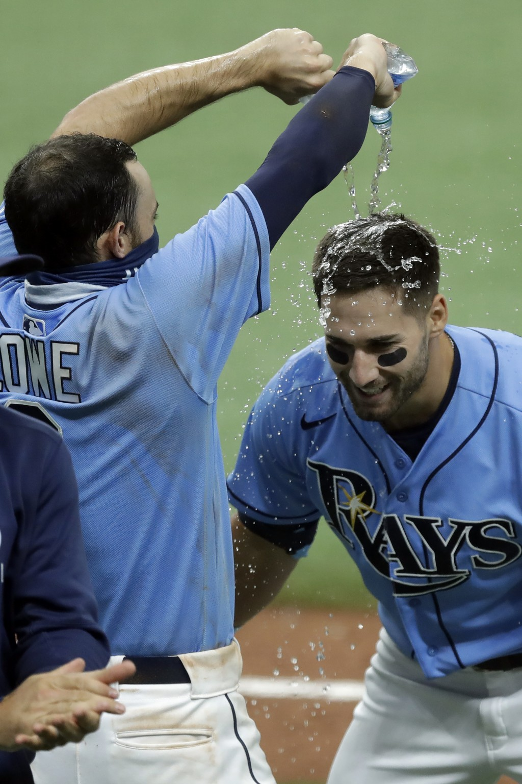 Tampa Bay Rays' Kevin Kiermaier, right, gets water poured on him by Brandon Lowe after Kiermaier hit a walk-off two-run double off Toronto Blue Jays r...