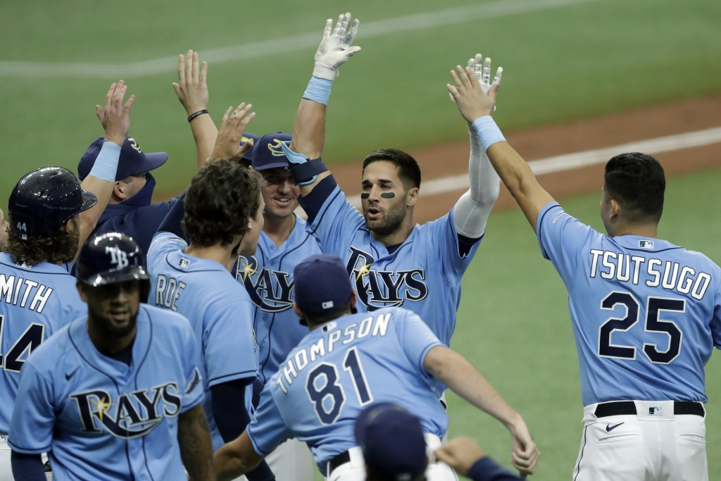 Tampa Bay Rays' Kevin Kiermaier, second from right, celebrates with teammates, including Yoshitomo Tsutsugo, of Japan, after his two-run walk-off doub...