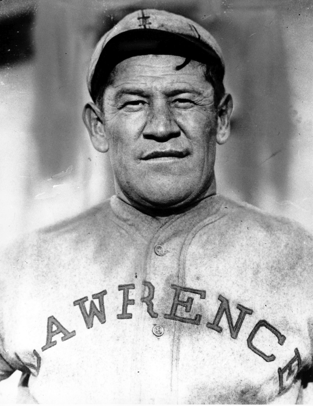 FILE - In this is undated file photo,  Jim Thorpe poses in a baseball uniform. Thorpe was on top of the world after winning gold medals in the decathl...