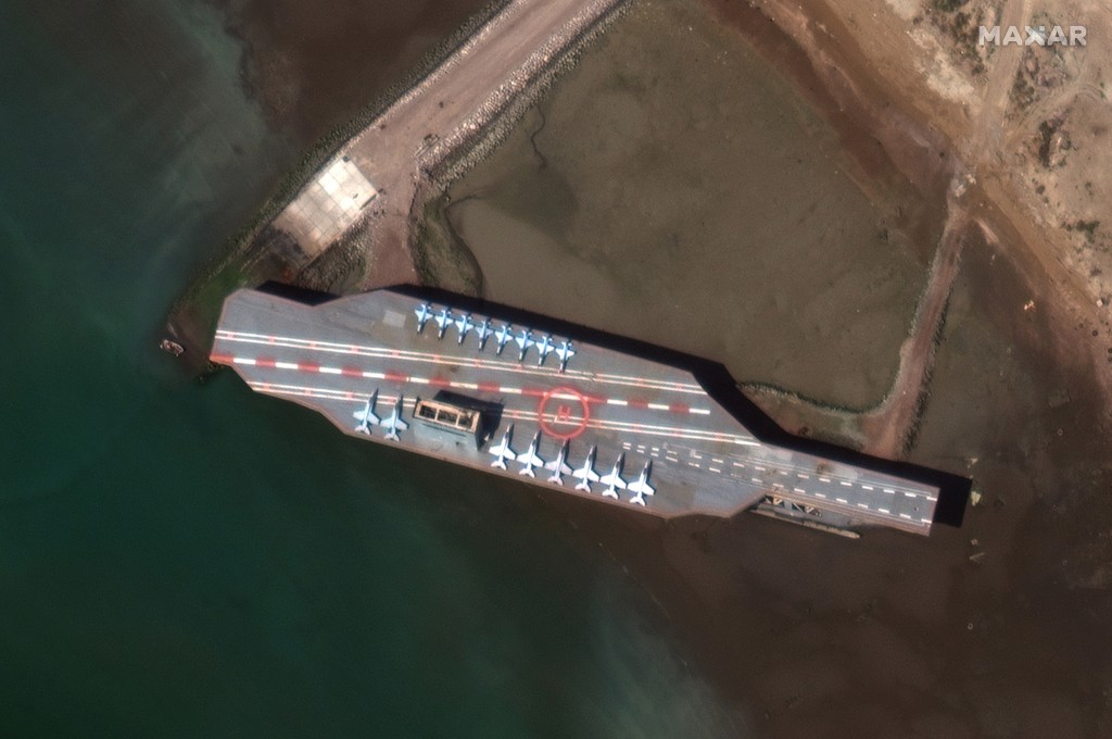 In this Feb. 15, 2020, satellite photo provided on July 27, 2020, by Maxar Technologies, a mockup aircraft carrier built by Iran is seen at Bandar Abb...