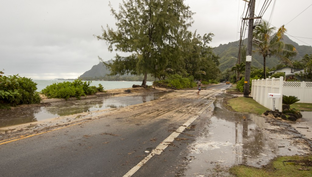 Sand and debris is left on Kamehameha Highway from high surf generated by Hurricane Douglas, Sunday, July 26, 2020, in Hauula, Hawaii. Hurricane Dougl...