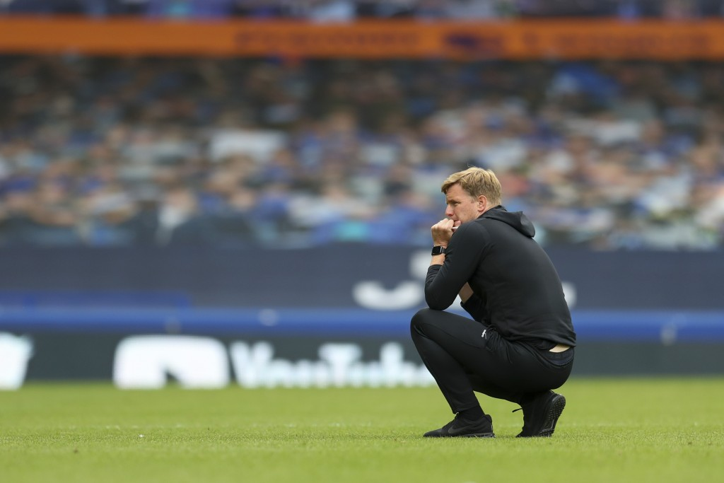 Bournemouth's manager Eddie Howe kneels on the pitch after their English Premier League soccer match between Everton and Bournemouth at Goodison Park ...
