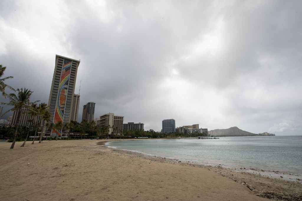 Waikiki Beach fronting the Hilton Hawaiian Village is deserted as Oahu residents take shelter before the arrival of Hurricane Douglas, Sunday, July 26...