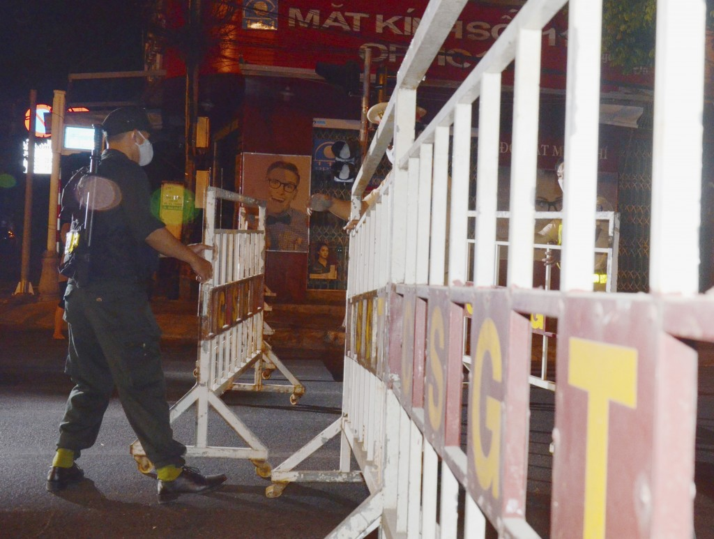 A security officer sets up barricades in Da Nang, Vietnam, early on Tuesday, July 28, 2020. Vietnam on Tuesday locked down its third-largest city for ...