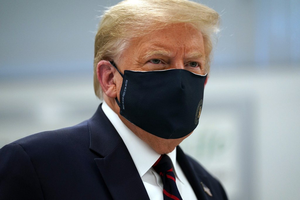 President Donald Trump wears a face mask as he participates in a tour of Bioprocess Innovation Center at Fujifilm Diosynth Biotechnologies, Monday, Ju...