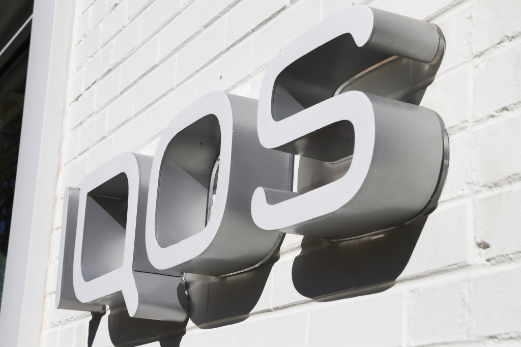 FILE - This Nov. 25, 2019 photo shows IQOS heated cigarette store sign in Richmond, Va.,  Altria said Tuesday, July 28, 2020,  that cigarette sales co...