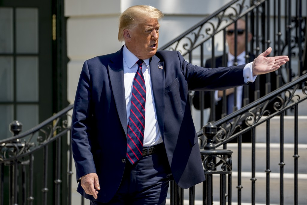 """President Donald Trump welcomes a group of supporters to come over to him as Terry Sharpe, known as the """"Walking Marine"""" arrives at the White House in..."""