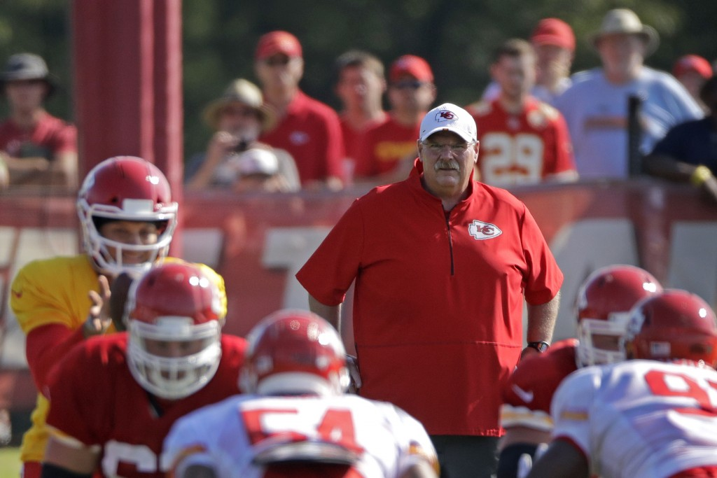 FILE - In this Monday, July 29, 2019, file photo, Kansas City Chiefs head coach Andy Reid watches a drill during NFL football training camp in St. Jos...