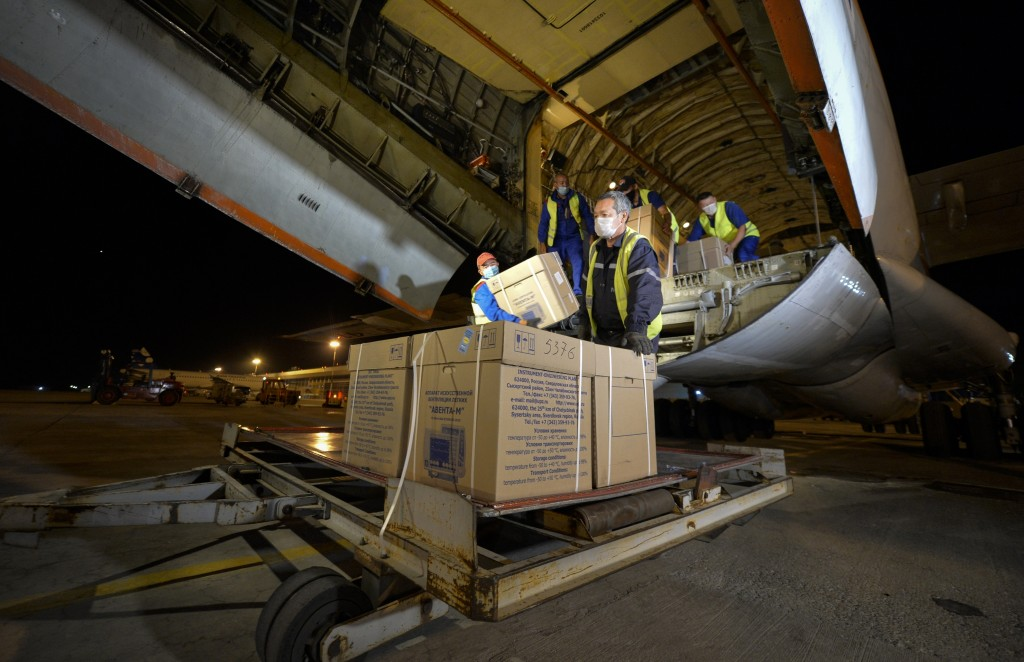 Workers at an airport outside Bishkek, Kyrgyzstan, Sunday, July 26, 2020, unload medical aid from Russia, including ventilators, to help Kyrgyzstan ta...