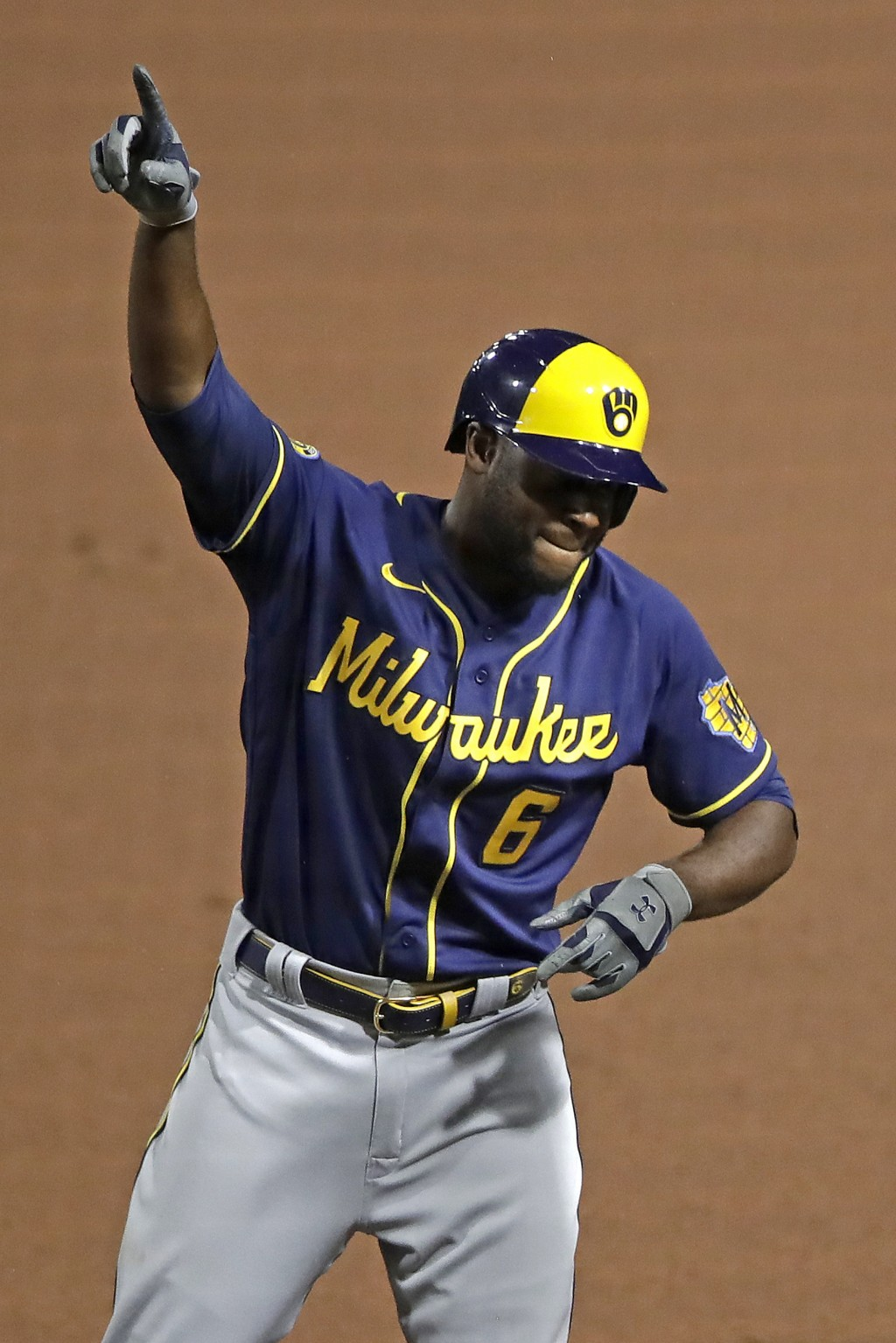 Milwaukee Brewers' Lorenzo Cain celebrates at first base after driving in a run with a single off Pittsburgh Pirates relief pitcher Nik Turley during ...