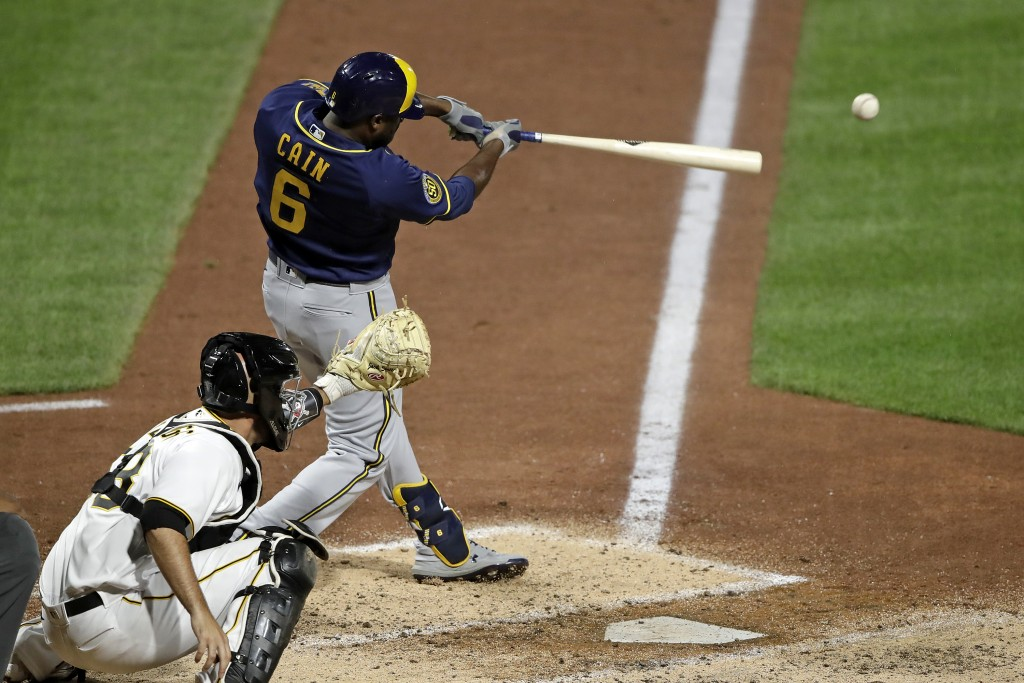 Milwaukee Brewers' Lorenzo Cain drives in a run with a single off Pittsburgh Pirates relief pitcher Nik Turley during the seventh inning of a baseball...