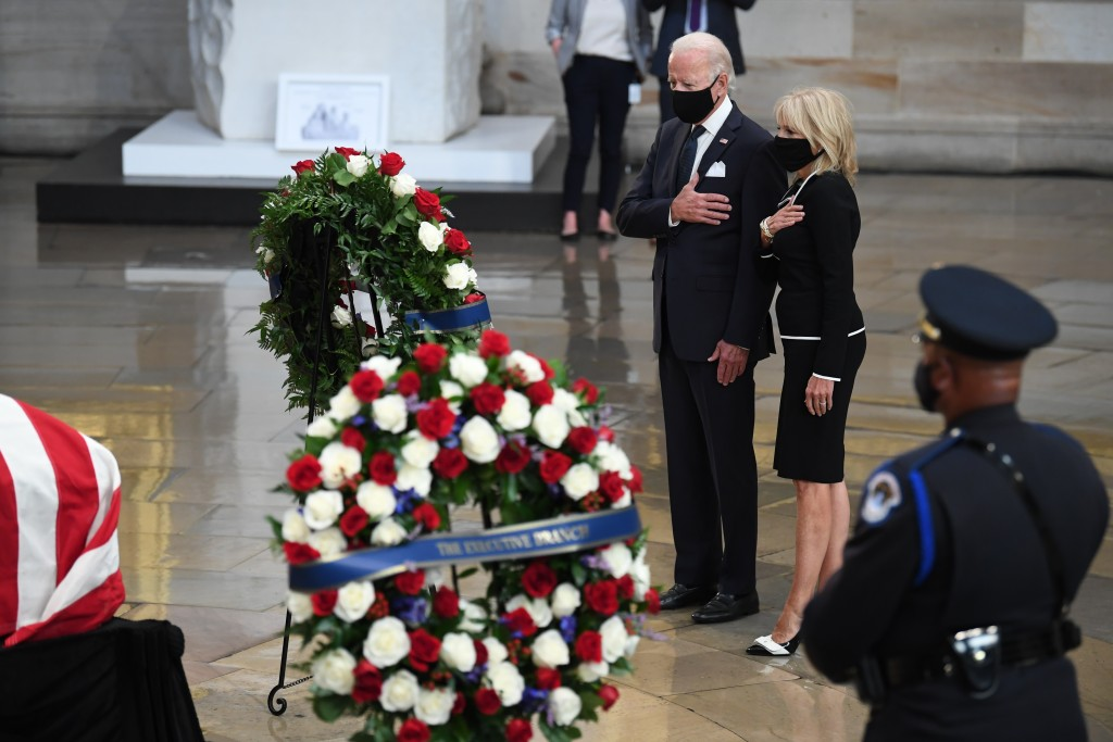 Democratic presidential candidate, former Vice President Joe Biden, and Jill Biden, pause by the flag-draped casket of the late Rep. John Lewis, D-Ga,...