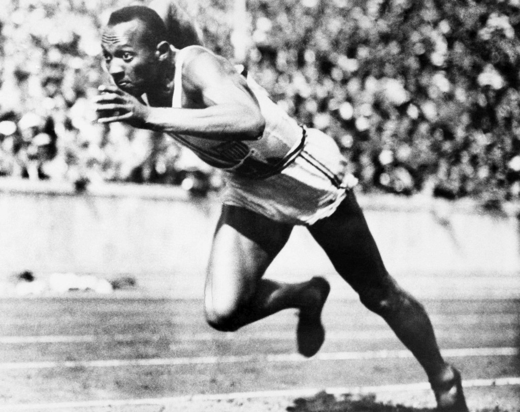 FILE - In this Aug. 14, 1936, file photo, American sprint star Jesse Owens is shown in action during one of the heats of the 200-meter run in Berlin. ...