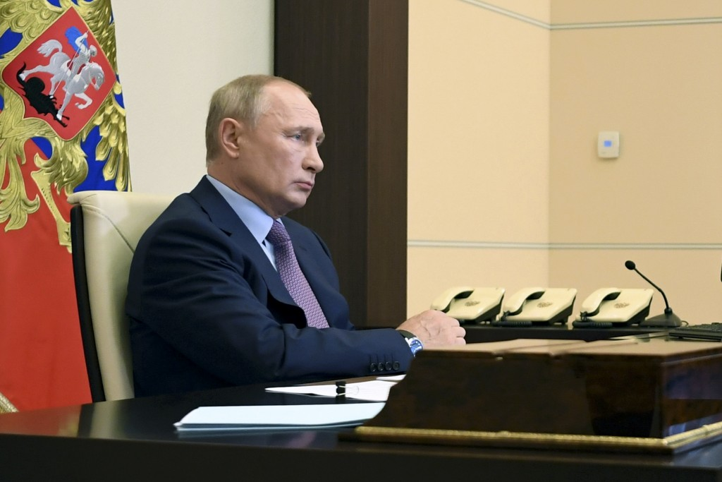 Russian President Vladimir Putin attends a cabinet meeting via a video conference at the Novo-Ogaryovo residence outside Moscow, Russia, Wednesday, Ju...