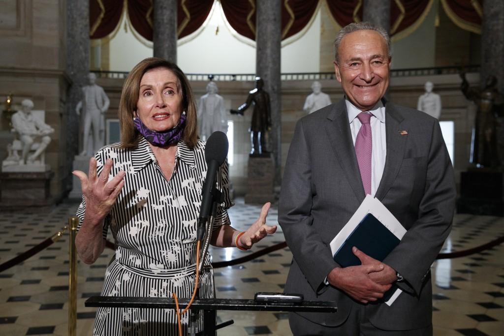House Speaker Nancy Pelosi of Calif., left, and Senate Minority Leader Sen. Chuck Schumer of N.Y., speak to the media, Tuesday, July 28, 2020, on Capi...